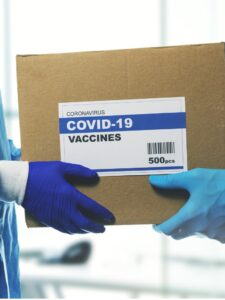 medical-worker-accepting-delivery-of-covid19-vaccines